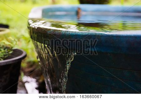 Water flowing out of the water storage containers.