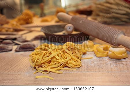 Tagliatelle And Tortellini Italian Pasta With Flour And Cutter Rolling Pin