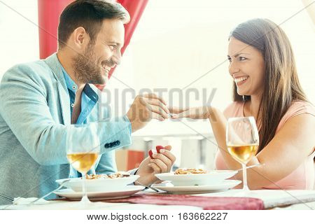 Love Couple In A Restaurant.