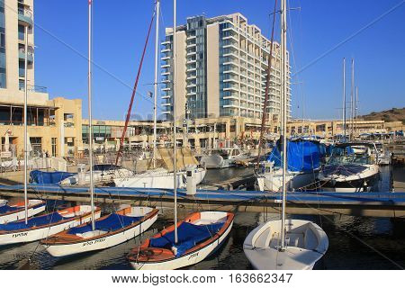 HERZLIYA, ISRAEL - AUGUST 28, 2015: Sailing yacht and promenade in Herzliya Marina, Israel. It's the largest and luxury marina in Israel.