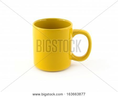 Big empty yellow tea or coffee cup isolated on white close up. Dishes studio shot
