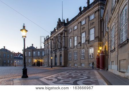 Copenhagen, Denmark - June 05, 2016: Evening photography of Amalienborg Palace and a royal guard