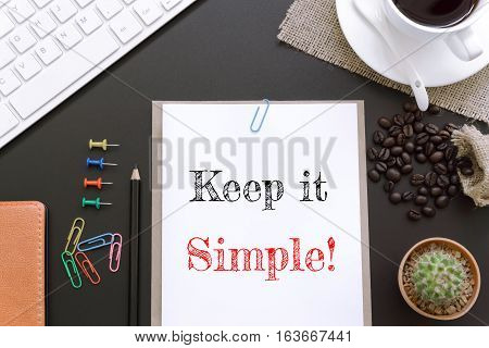 Text Keep it simple on white paper background / business concept