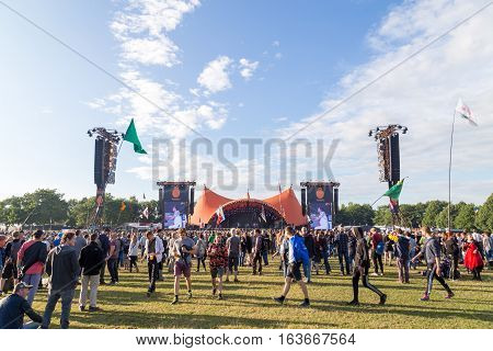 Roskilde, Denmark - June 30, 2016: Crowd of spectators enjoying a concert at the orange stage at Roskilde Festival 2016