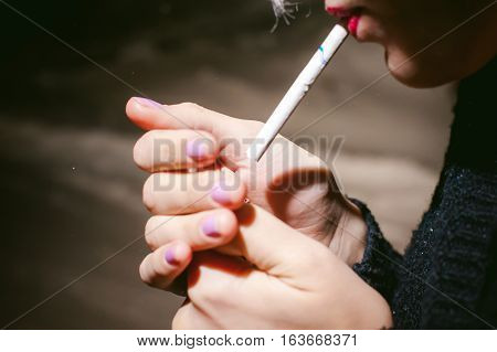 Portrait Of A Girl With A Cigarette. Young Beautiful Girl Hipster With Dyed Hair Smoking A Cigarette