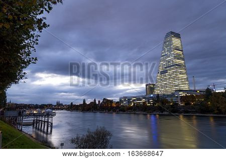 Basel, Switzerland - October 20, 2016: View of the Rhine River with the illuminated Roche Tower