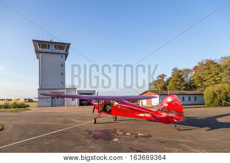 Bremgarten, Germany - October 22, 2016: A classic red Cessna 170 aircraft parked at the airport