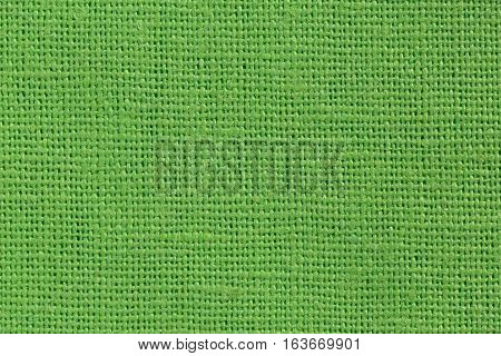 Light green Linen Fabric Background close up