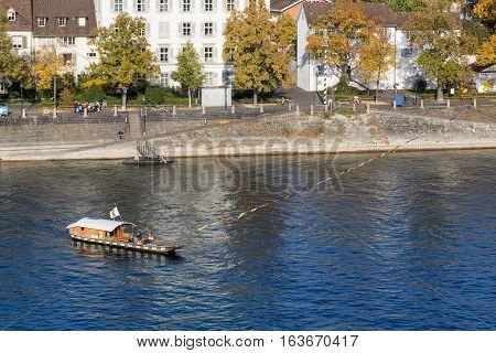 Basel, Switzerland - October 24, 2016: Historic passenger ferry crossing the Rhine river
