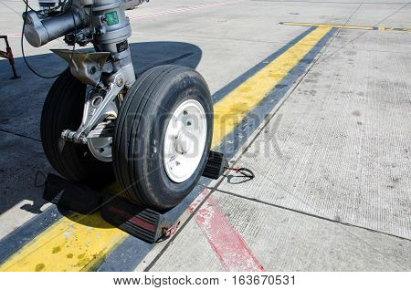 Aereplane Wheel Chock for Pause Aeroplane Safety in The Airport.Aeroplane Wheel Chock made from Black Rubber and Metal.