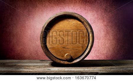 Wooden barrel on a textured pink background