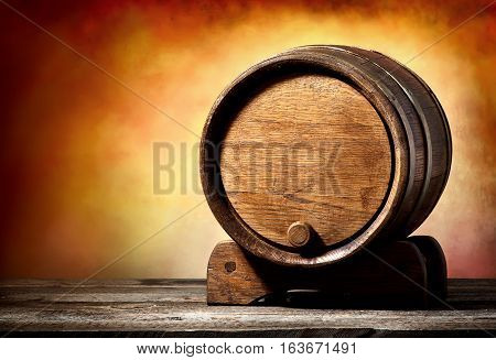 Wooden cask on a stand on a colored background