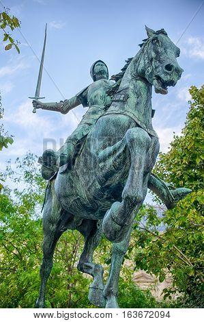 Statue of Jeanne d'Arc on horseback with sword in Reims, september France