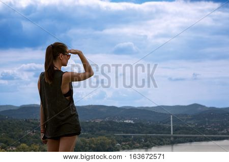 young lonely girl looking far away distance