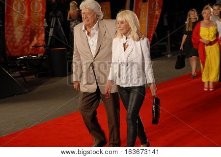 ANTALYA/TURKEY-OCTOBER 18: Famous Turkish Film Actor Cuneyt Arkin (L) and hid wife on the Antalya Golden Orange Film Festival's Red Carpet. October 18, 2014-Antalya/Turkey