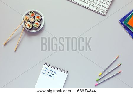 Top View Office Work Place On Grey Desk Sushi Schedule