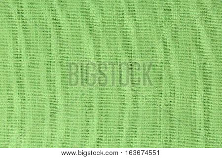Bright Green Fabric Background With Clear Canvas Texture