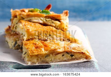 Cheese and herb savory pies on board