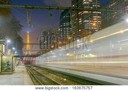 Paris subway station with speeding train blur. France.
