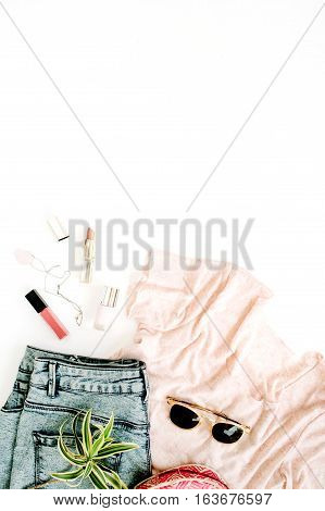 Trendy feminine clothes and accessories. Flat lay top view