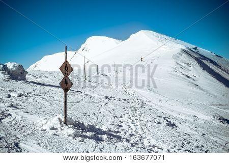 Way on mountains, winter mountain trail, european tour in snowy mountains, symbol journey life