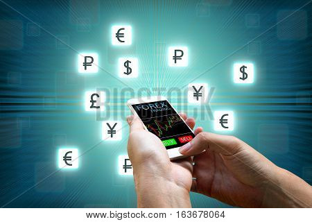 Forex concept Businessman holding smart phone and currency icon.