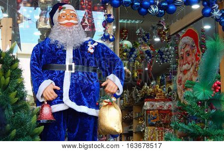 HYDERABAD,INDIA-DECEMBER 23:Santa Claus figure kept in front of Retail shop selling Christmas decorative items on December 23,2016 in Hyderabad,India.