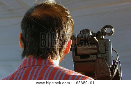 professional video camera man and video camera