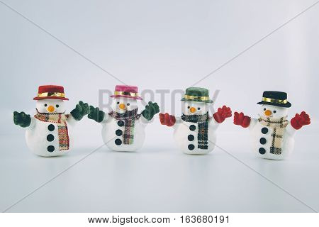 Gang Of Snowman Stand On White Background.