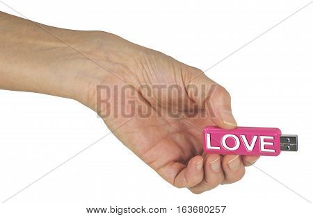 A USB filled with Information on Love - female hand holding out a pink USB stick with LOVE engraved in white on the side, isolated on a white background