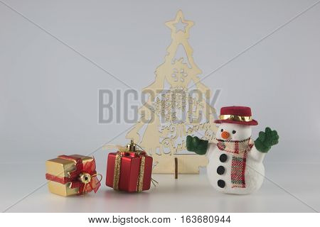 Snowman Stand Near Christmas Tree