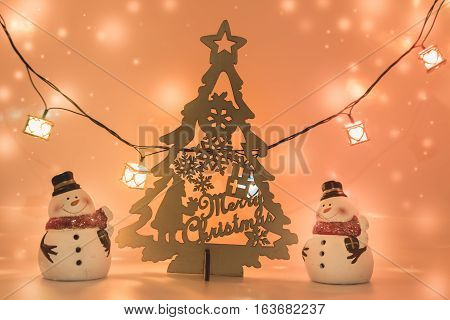 2 Snowman Stand Near Christmas Tree.
