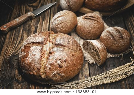 pieces of wholemeal bread on board with shallow depth of field
