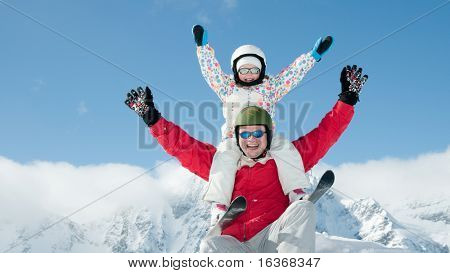Father and daughter have fun on ski