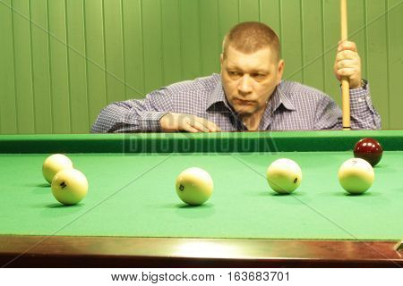 The game of Billiards. Russian Billiards. A man plays Billiards