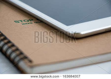 Put Tablet On Notebook.