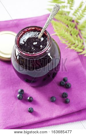 Bilberry confiture in a smal glass jar