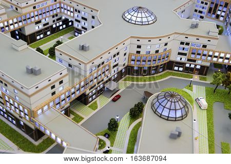 Hospital scale model, layout of medical building, miniature of big city healthcare centre with infrastructure, ambulance service, modern architecture and design, selective focus