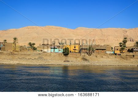 Village along the shore of the Nile River in Egypt Africa