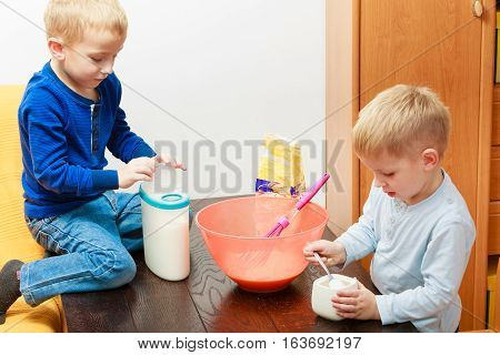 Two Kid Boys Cooking, Making Cake In Bowl