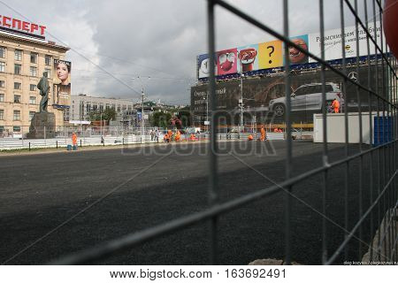 Moscow, Russia - August 25, 2010. Mayakovsky monument behind the fence reconstruction. On Triumphalnaya square in Moscow began the construction work