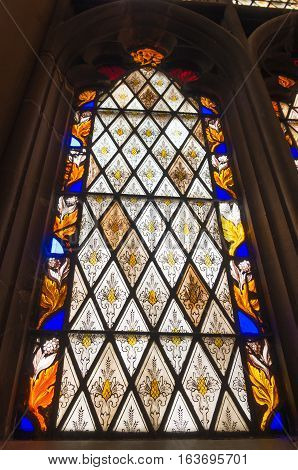 NEW YORK - APRIL 27 2016: Stained glass window in the Trinity church in downtown manhattan