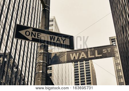 NEW YORK - APRIL 27 2016: Vintage street sign of wall street in downtown manhattan