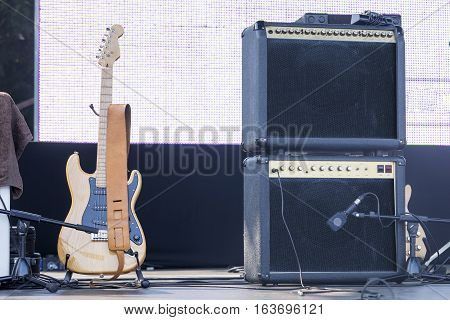 Live Concert Scene  Bass Guitar And Speakers