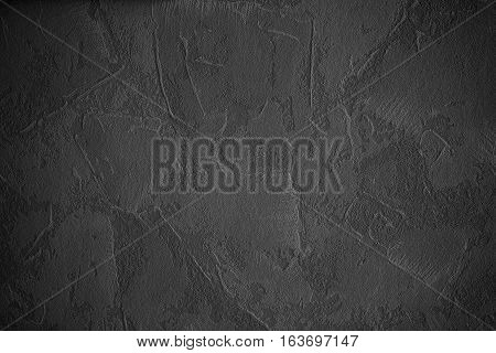 Abstract grunge wall background with space for text or image. Stone grunge texture with dark theme.