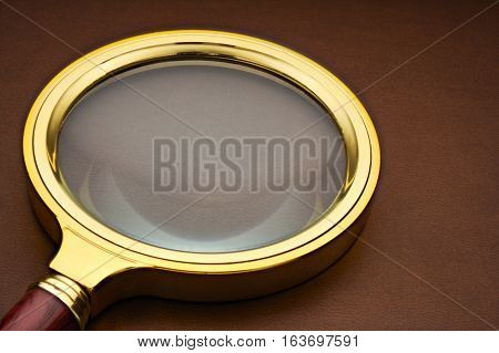 Magnifier on the leather surface. detective magnifier