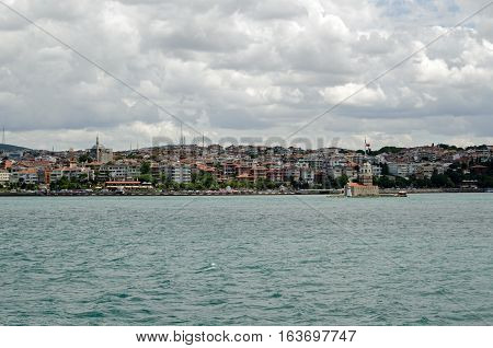 View from the Bosphorus strait of the Uskudar district of Istanbul on the Asian side of the city with the landmark Maiden's Tower to the right hand side.