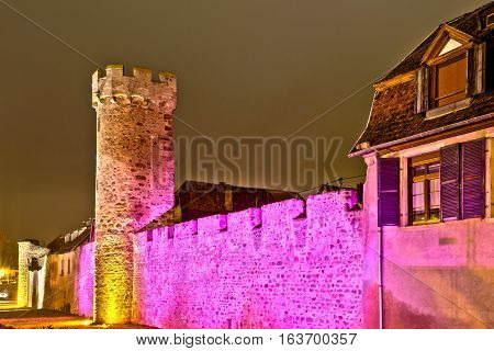 Old Medieval Fortress Wall Highlighted At Night