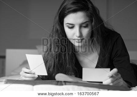 Woman Filling A Photo Album