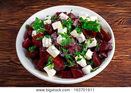 Healthy beetroot, feta cheese salad with parsley.